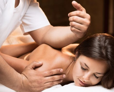 Woman receives Deep Tissue Massage