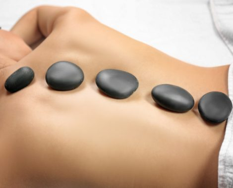 Woman receives hot stone massage